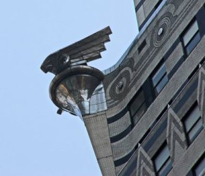 Circular motifs meet the zig-zag V-shapes; Art Deco's Egyptian and Mayan influences. Chrysler's symbol, a stainless steel eagle, has landed in a corner.